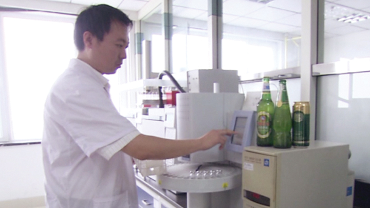 A worker at Tsingtao Brewery in China.